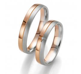 Eleganckie obrączki ślubne z dwóch kolorów złota - białego i czerwonego - z oryginalnie oprawionym brylantem