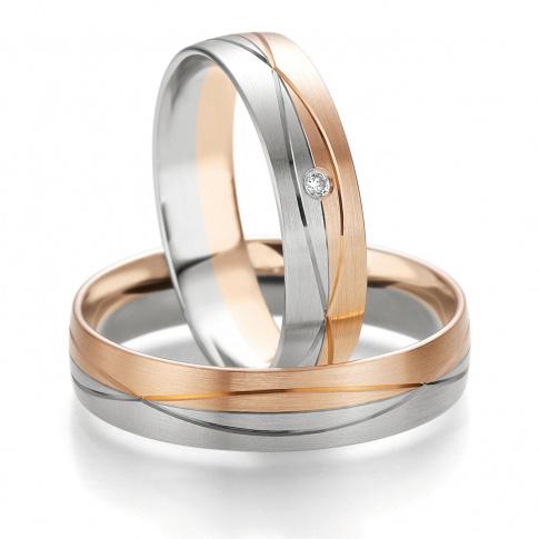 Niebanalne obrączki ślubne - duet białego i czerwonego złota - z delikatnymi nacięciami