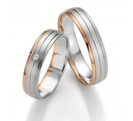 Bardzo popularne obrączki ślubne Breuning z białego i czerwonego złota z brylantem