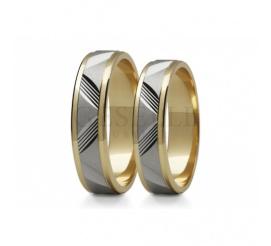 Obrączki ślubne z białego i żółtego złota zdobiony efektownymi diamentowanymi nacięciami