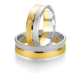 Dwukolorowe obrączki ślubne z białego i żółtego złota - dwa zespolone pierścienie