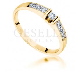 Niezwykły, luksusowy pierścionek z żółtego złota 14K z brylantami o masie 0.17 ct - przepych i elegancja od GESELLE Jubiler