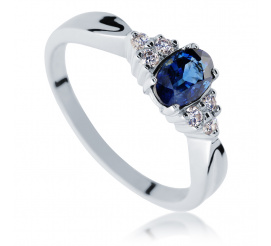 Cieszący się popularnością pierścionek zaręczynowy z owalnym szafirem i brylantami 0.09 ct z białego złota