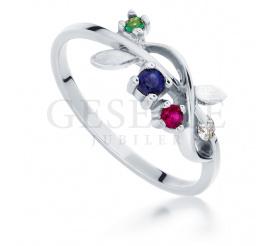 Nietuzinkowy pierścionek zaręczynowy z białego złota ze szmaragdem, rubinem, szafirem i brylantem