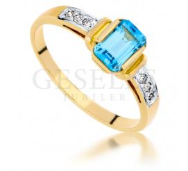 Oryginalny pierścionek zaręczynowy z żółtego złota 14K z topazem blue i brylantami, hit z kolekcji GESELLE Jubiler