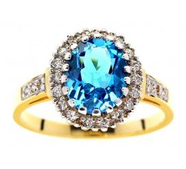 Królewski, złoty pierścionek z topazem blue i brylantami o łącznej masie 0,30 ct