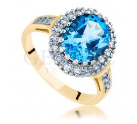 Królewski, złoty pierścionek z topazem blue i brylantami o łącznej masie 0.30 ct