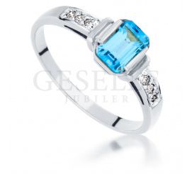 Elegancki pierścionek zaręczynowy - białe złoto, topaz blue i brylanty