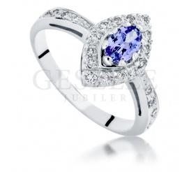 Bogaty pierścionek z białego złota z unikatowym, owalnym tanzanitem i lśniącymi brylantami