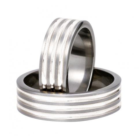 Eleganckie i solidne obrączki z tytanu z delikatnymi liniami ze srebra