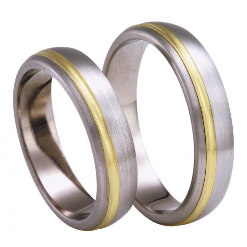 Ponadczasowe obrączki ślubne z tytanu, zdobione subtelną linią klasycznego, żółtego kruszcu