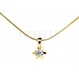 Złoty wisiorek w kształcie delikatnej gwiazdki z brylantem 0,09 ct w klasycznym stylu