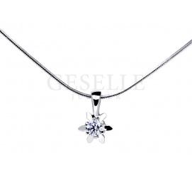 Złota, klasyczna zawieszka w kształcie gwiazdki z białego złota z brylantem 0,09 ct