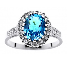 Królewski pierścionek w stylu retro - białe złoto próby 585, majestatyczny topaz blue i wieczne brylanty o masie 0.30 ct