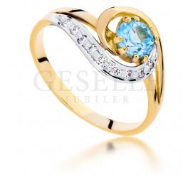 Nowoczesny pierścionek zaręczynowy z modnym topazem swiss blue i białymi brylantami