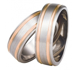 Duet czerwieni i srebra - obrączki ślubne ze złota i tytanu