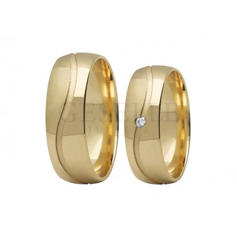 Wspaniałe obrączki ślubne z żółtego złota z jednym lśniącym kamieniem - cyrkonią Swarovski ELEMENTS lub brylantem