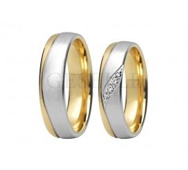 Dwukolorowe obrączki ślubne z białego i żółtego kruszcu z lśniącymi kamieniami i wyoblonym wnętrzem