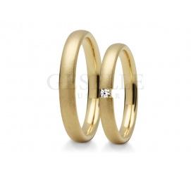 Nowoczesne, wąskie obrączki ślubne z żółtego złota pr. 585 z cyrkonią lub brylantem