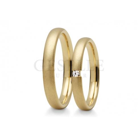 Nowoczesne, wąskie obrączki ślubne z żółtego złota z cyrkonią lub brylantem