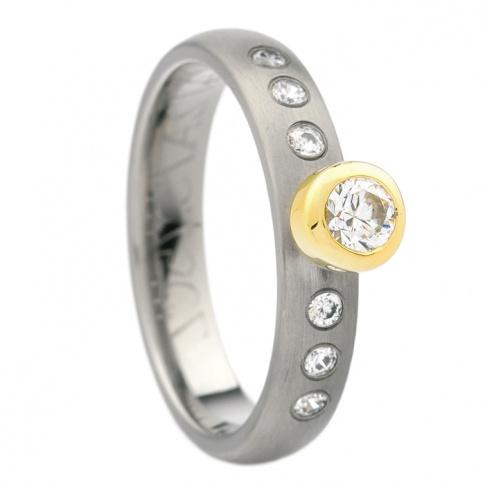 Nowoczesny pierścionek z tytanu i żółtego złota 18K z 7 cyrkoniami
