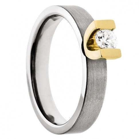Niepowtarzalny pierścionek z tytanu i żółtego złota z lśniącą cyrkonią