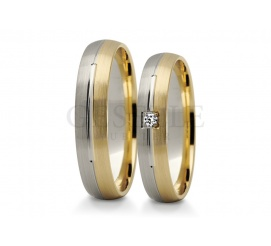 Para obrączek ślubnych z kolekcji Stelmach z białego i żółtego złota z cyrkonią lub brylantem