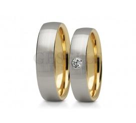 Elegancki komplet obrączek z cyrkonią lub brylantem na pięknej szynie z dwukolorowego złota