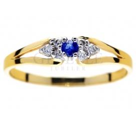 Oryginalny, złoty pierścionek zaręczynowy z niebieskim szafirem i brylantami 0,06 karata