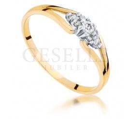 Złoty pierścionek zaręczynowy z 7 brylantami o łącznej masie 0,11 ct
