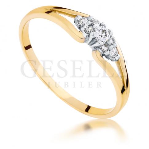 Złoty pierścionek zaręczynowy z 7 brylantami o łącznej masie 0.11 ct