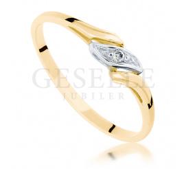 Subtelny i elegancki pierścionek z żółtego złota z brylantem o masie 0.01 ct