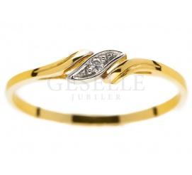 Subtelny i elegancki pierścionek z żółtego złota z brylantem o masie 0,01 ct