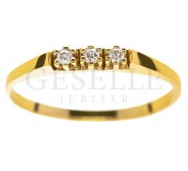 Złoty pierścionek pr. 585 z 3 brylantami o łącznej masie 0,04 ct
