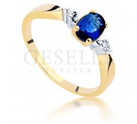 Złoty 14-karatowy pierścionek z szafirem naturalnym i brylantami o masie 0,03 ct