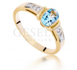 Luksusowy pierścionek od GESELLE Jubiler: żółte złoto 14K, błękitny topaz blue i diamenty o masie 0,06 ct