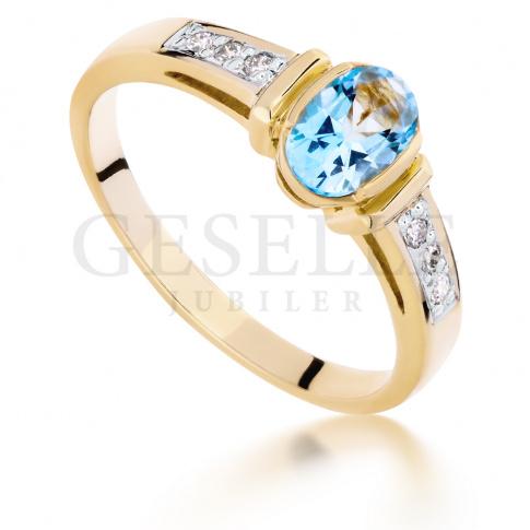 Luksusowy pierścionek: żółte złoto, błękitny topaz blue i diamenty o masie 0.06 ct