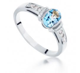 Niebanalny pierścionek w stylu retro z białego złota z topazem blue i wiecznymi brylantami