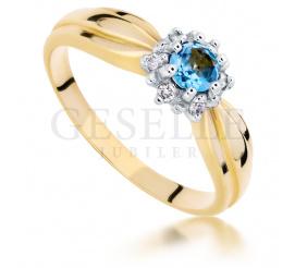 Zjawiskowy pierścionek  zaręczynowy z żółtego złota z topazem blue i brylantami