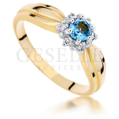 Zjawiskowy pierścionek - zaręczynowy z żółtego złota z topazem blue i brylantami
