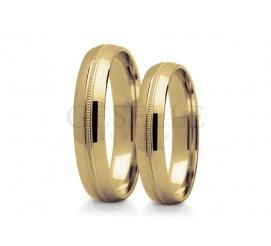 Obrączki ślubne w klasycznym stylu - żółte złoto próby 585 i subtelne zdobienie