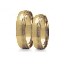Eleganckie obrączki ślubne z klasycznego kruszcu próby 585 z ozdobną krawędzią