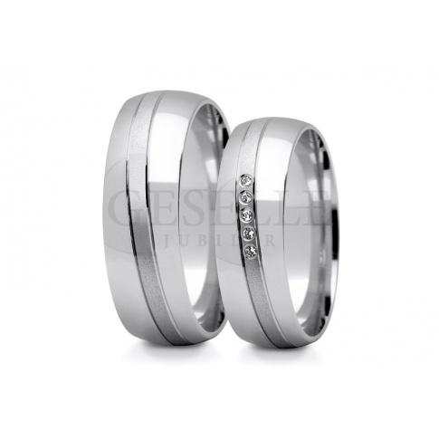 Eleganckie i stylowe obrączki ślubne z białego kruszcu z subtelną falą kamieni