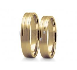 Elegancki komplet klasycznych obrączek ślubnych - wspaniały kruszec, łagodny profil, delikatne kamienie