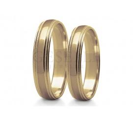 Proste obrączki ślubne z klasycznego kruszcu z ozdobnymi krawędziami