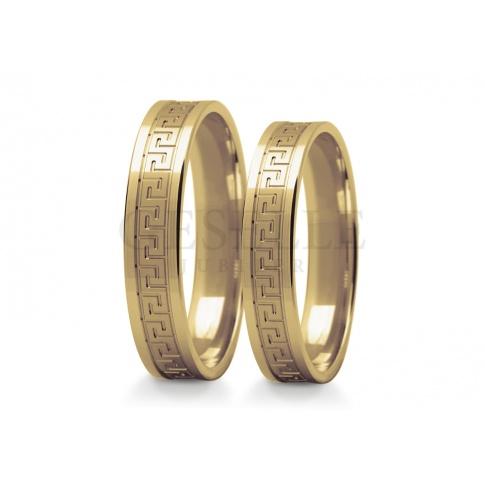 Niebanalny komplet obrączek z żółtego złota z pięknym, greckim wzorem na szynie