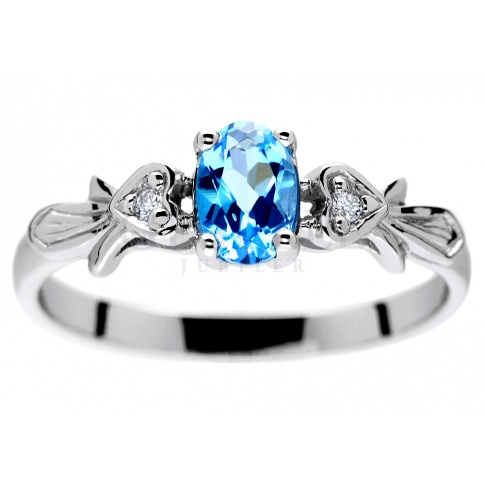 Niezwykły pierścionek zaręczynowy z topazem swiss blue i brylantami zamkniętymi w oprawie w kształcie serc