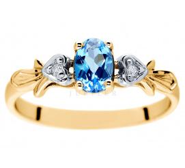 Pełen elegancji pierścionek zaręczynowy z intensywnie błękitnym topazem i brylantami w duecie z żółtym złotem pr. 585
