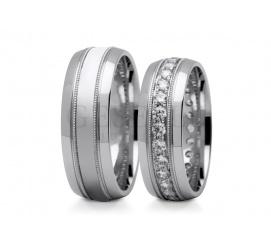 Wyrazisty i oryginalny duet obrączek ślubnych z białego złota z polerowanymi półokrągłymi brzegami oraz cyrkoniami