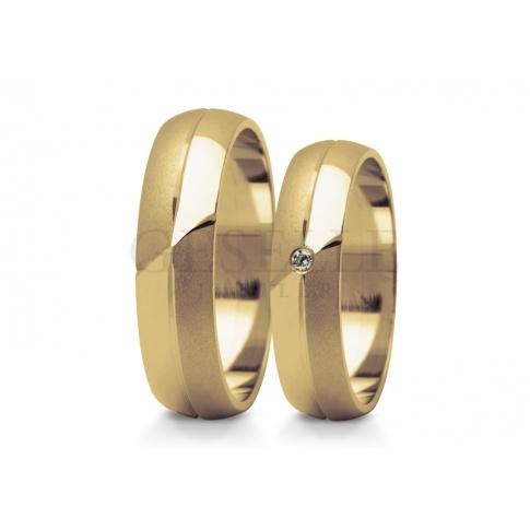 Wyjątkowe obrączki ślubne z efektownym matowaniem i diamentowaną linią zwieńczone cyrkonią Swarovski Elements lub olśniewającym brylantem